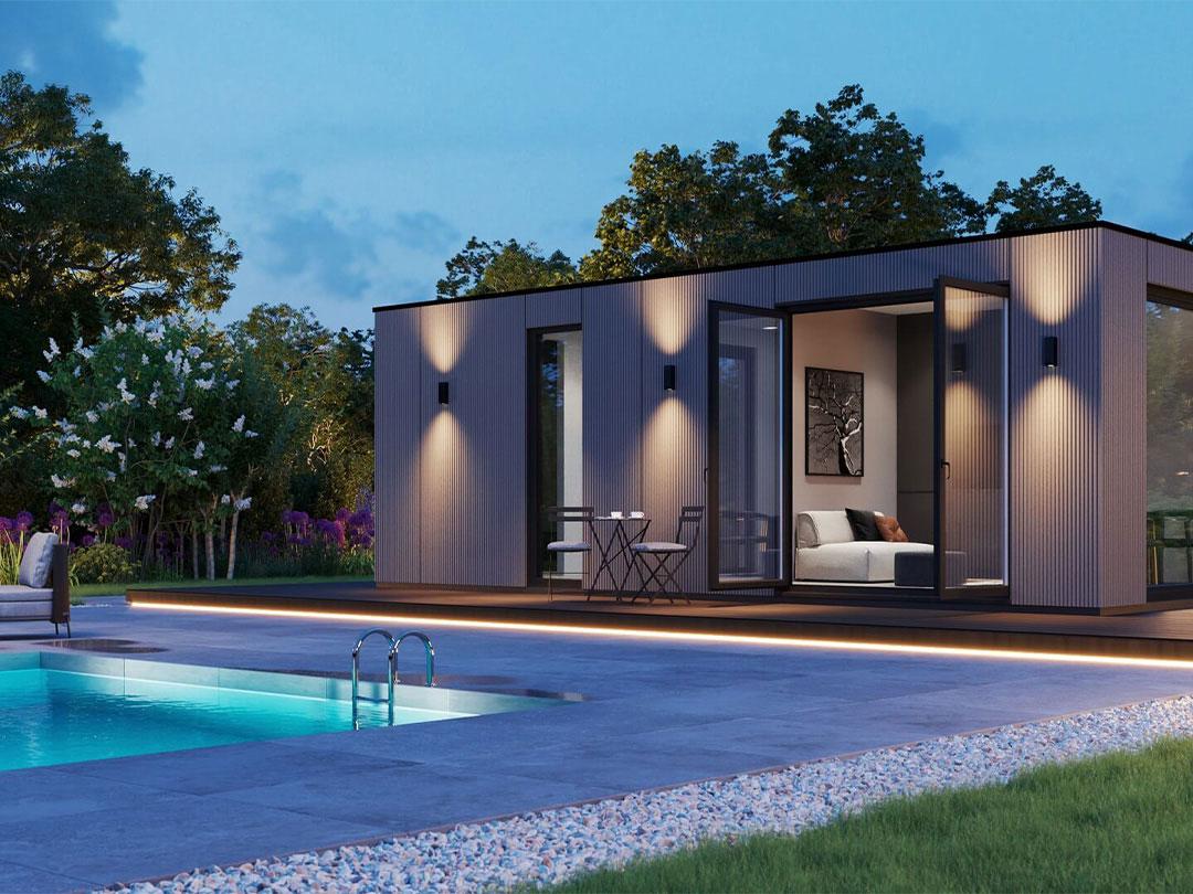 Iso bella vivlux poolhouse met verlichting bij het zwembad